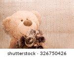 Teddy Bear Holding A Flower...
