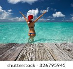 woman in santa's hat in bikini... | Shutterstock . vector #326795945