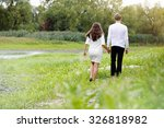 young couple walking through a...   Shutterstock . vector #326818982