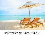umbrella and beach chair with... | Shutterstock . vector #326823788