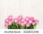 Stock photo pink roses bouquet over wooden table top view with copy space 326831348