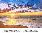 brilliant ocean beach sunrise. | Shutterstock . vector #326835206