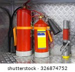 Two Fire Extinguishers And...
