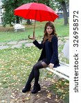 girl with a red umbrella autumn ... | Shutterstock . vector #326958572