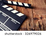movie clapper on wood table   Shutterstock . vector #326979026
