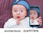 Baby Boy Taking Selfie With A...