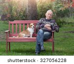 cute dog sitting next to his... | Shutterstock . vector #327056228
