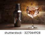gin tonic on a wooden background | Shutterstock . vector #327064928