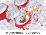 Close Up of Soda Cans in Ice with Straw and Condensation - stock photo