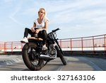 Portrait Of Female Model Biker...