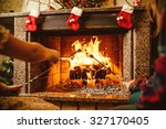family roasting marshmallows by ... | Shutterstock . vector #327170405