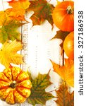 autumn maple leaves and pumpkins | Shutterstock . vector #327186938