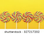 Bright Rainbow Lollipop Candy...