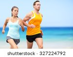 runners running on beach.... | Shutterstock . vector #327224792