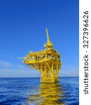 Small photo of Offshore oil and gas wellhead platform with blue sky and sea, Gulf of Thailand