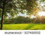 green grass on a sunny meadow... | Shutterstock . vector #327430532