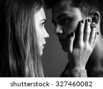 young man and woman in dark... | Shutterstock . vector #327460082