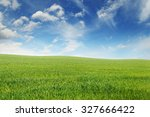 spring meadow and blue sky | Shutterstock . vector #327666422