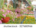 many colorful flowers in front... | Shutterstock . vector #327680966