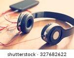headphones with cellphone on... | Shutterstock . vector #327682622