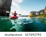 lady paddling the kayak in the... | Shutterstock . vector #327692792