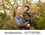 young dad lifting his little... | Shutterstock . vector #327729782