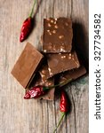 chocolate and peppers on a... | Shutterstock . vector #327734582