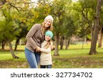 young mother with her daughter... | Shutterstock . vector #327734702