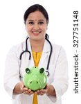 Doctor Woman Holding A Piggy...