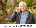 senior man in the park on an... | Shutterstock . vector #327757868