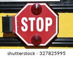 Stop sign on the side of a typical yellow school bus
