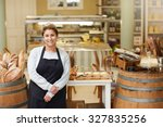 a young deli employee standing...   Shutterstock . vector #327835256