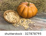 orange pumpkin with seeds on a... | Shutterstock . vector #327878795