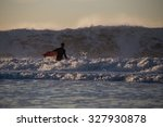 Surfer About To Paddle Out In...