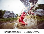 woman splashing in muddy... | Shutterstock . vector #328092992