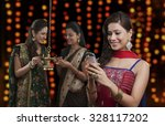 young women celebrating diwali | Shutterstock . vector #328117202