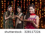 young women celebrating diwali | Shutterstock . vector #328117226