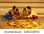 family arranging diyas on... | Shutterstock . vector #328118552