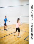couple playing a game of squash ... | Shutterstock . vector #328149182