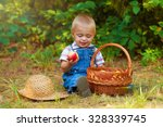 little boy with a basket of... | Shutterstock . vector #328339745