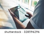 guy holding tablet in a hand... | Shutterstock . vector #328596296