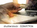 hands using laptop and holding... | Shutterstock . vector #328697936