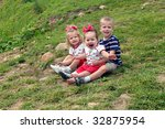 family of three sit outdoors on ... | Shutterstock . vector #32875954