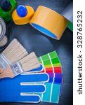 Small photo of Paint can bottle color sampler protective gloves paintbrushes adhesive tape.