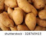 many potato on a wooden kitchen ... | Shutterstock . vector #328765415