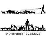 Stock photo two foreground silhouettes of a man walking many dogs 32882329