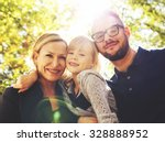 a cute family posing in a park... | Shutterstock . vector #328888952