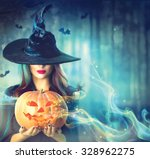 Stock photo halloween witch with a magic pumpkin in a dark forest beautiful young woman in witches hat and 328962275