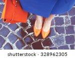 Women's Legs In Orange Shoes....