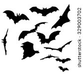a set of silhouettes of bats | Shutterstock .eps vector #329003702